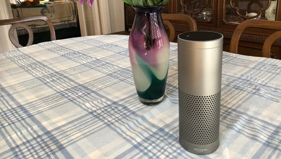 The Amazon Echo speaker and a vase of flowers