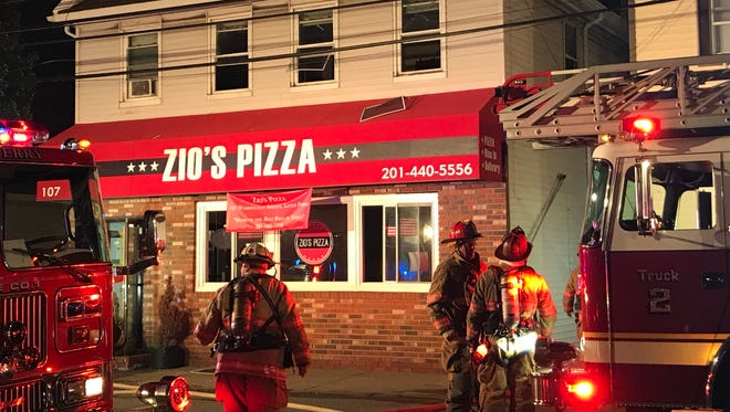 Firefighters battled a blaze at a Washington Avenue pizza place in Little Ferry Wednesday night.