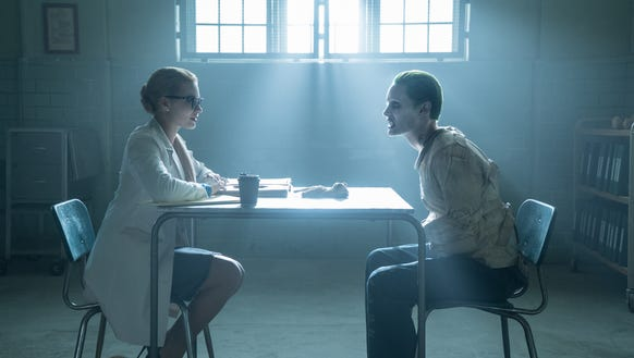(L-R) Margot Robbie as Harley Quinn and Jared Leto