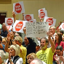 Members of the public show their disapproval of Duke Energy's proposal to build a new tie-in station in Campobello during a public comment session before commissioners with the S.C. Public Service Commissioners at Landrum High School.