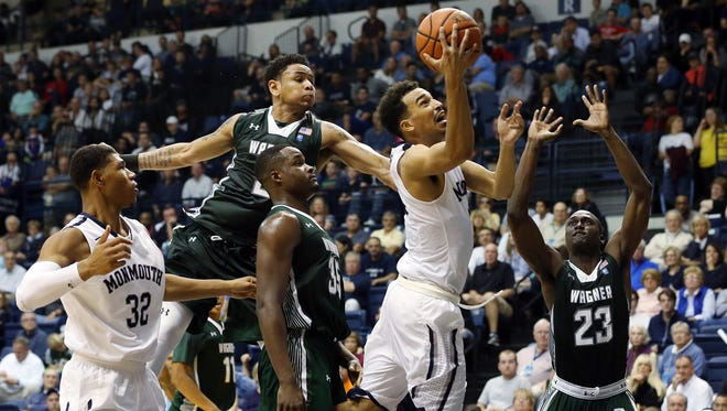 Monmouth's Micah Seaborn drives to the hoop during the second half of the Hawks 73-54 win over Wagner, Sunday, December 13, 2015, in West Long Branch.