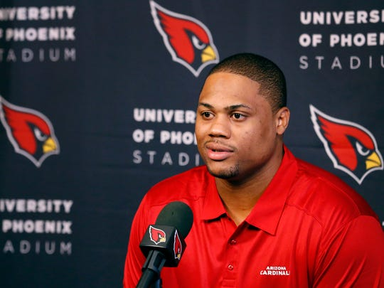 Arizona Cardinals defensive tackle Corey Peters meets with the media Wednesday, March 11, 2015 at the Cardinals training facility in Tempe,  Ariz.  Peters, formerly with the Falcons, is expected to sign a three-year contract.