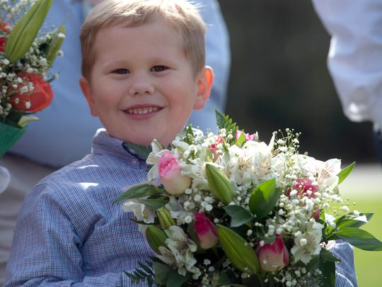 Holton Jones, 5, is alive today because his sister, Peyton, made a called to 9-1-1 that helped save his life. Santa Rosa County and Lifeguard officials honored the boy's sister, Peyton and the Jones' during a ceremony at Sims Middle School Thursday morning.