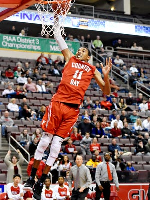 York Country Day's Jalen Gorham takes the ball to the basket during boys' District 3 Class 1-A basketball championship action against Lancaster Country Day at Giant Center in Hershey, Wednesday, Feb. 28, 2018. York County Day would win the game 61-54. Gorham had decided to transfer for his senior season to The MacDuffie School in Massachusetts. Dawn J. Sagert photo