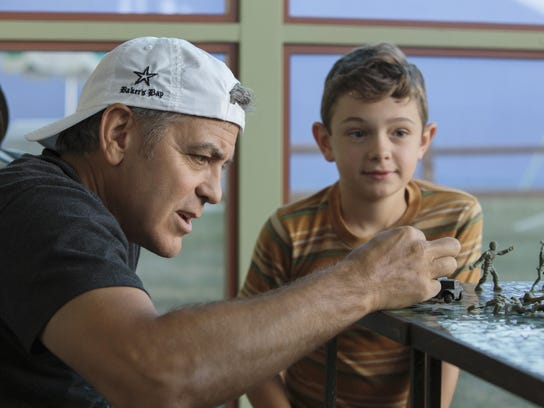 George Clooney directs actor Noah Jupe on the set of