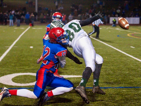 Hartford's Tyler Hamilton, left, prevents St. Johnsbury's Jasper Rankin from catching a pass during the Division 1 high school football state championship in Rutland on Saturday, November 12, 2016.