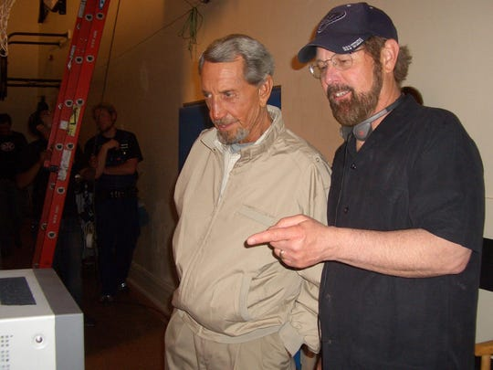 """David O'Malley and actor Roy Scheider check the playback of a scene during the filming of """"Dark Honeymoon"""" in 2008."""