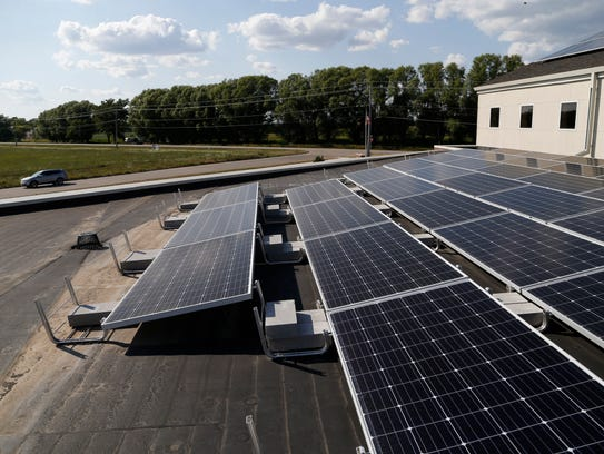 Solar panels can be seen on the roof Saturday, Aug.