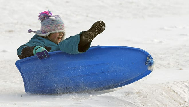 Audrey Neumann takes her sled over a bump Sunday at Reid Municipal Golf Course in Appleton.