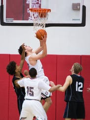 Wade Hampton's Will Edwards (42) shoots the ball during