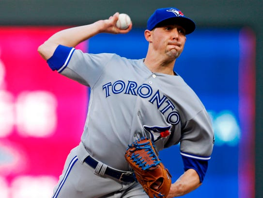 Toronto Blue Jays' pitcher Aaron Sanchez throws against