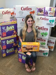 Melanie Coppola donating diapers to the .Buggy Bunch