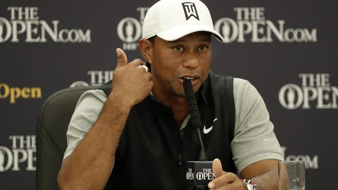 """Tiger Woods of the United States speaks at a press conference ahead of the start of the British Open championships at Royal Portrush in Northern Ireland on July 16, 2019. In a tweet Monday night, June 1, Woods wrote of the protests across the country, """"We can make our points without burning the very neighborhoods we live in,"""" and added, """"I hope that through constructive, honest conversations we can build a safer, unified society."""""""