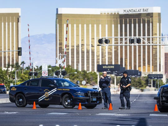 Police stand at a roadblock on Las Vegas Boulevard