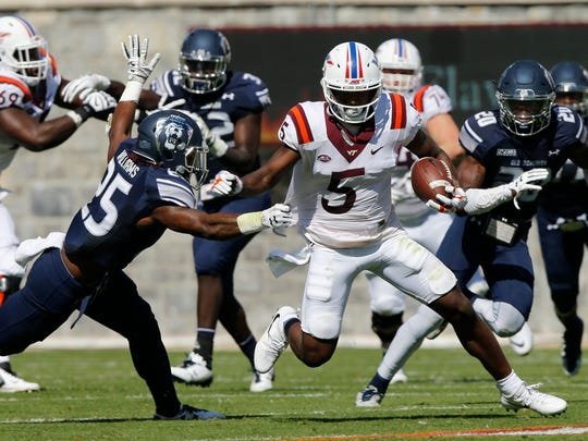 Virginia Tech wide receiver Cam Phillips (5) breaks the tackle of Old Dominion safety Denzel Williams (25)during the first half of the Old Dominion Virginia Tech NCAA college football game in Blacksburg, Va., Saturday, Sept. 23, 2017. (AP Photo/Steve Helber)