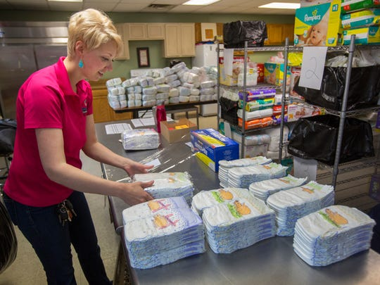 Megan Fischer, CEO of Sweet Cheeks Diaper Bank, packages diapers that will go out to14 different social service agencies and their families in need. Diapers are not covered by food stamps or WIC. The non-profit services about 900 children a month, which Fischer says barely scratches the surface. Based on census and poverty data, there's about 16,000 children experiencing diaper need, she said.