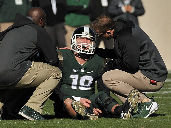 Michigan State starting quarterback Connor Cook grimaces