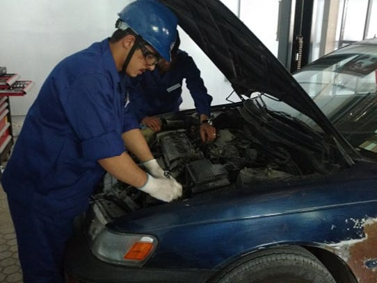 A student works at the Kabul automotive training center, run by Bloomfield Hills-based TTi Global, in July 2016. CEO Lori Blaker has earned international recognition for creating jobs programs in the conflict zone.