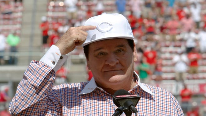 Jun 25, 2016; Cincinnati, OH, USA; Cincinnati Reds former player Pete Rose points to his hat while speaking during his Reds Hall of Fame induction ceremony before a game with the San Diego Padres at Great American Ball Park. Mandatory Credit: David Kohl-USA TODAY Sports