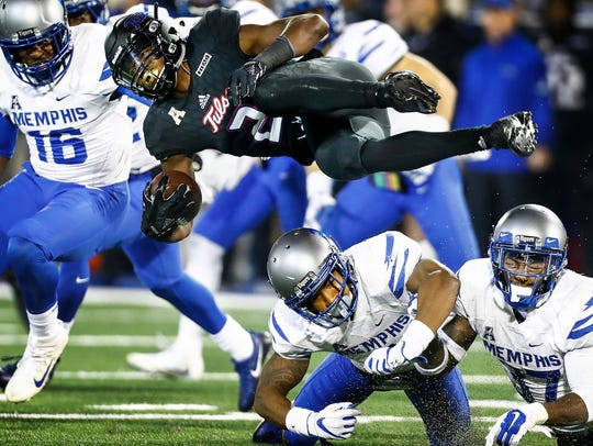 University of Tulsa kicker returner Keylon Stokes (top)