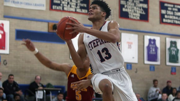 Stepinac's Xavier Wilson (13) goes up for a shot against