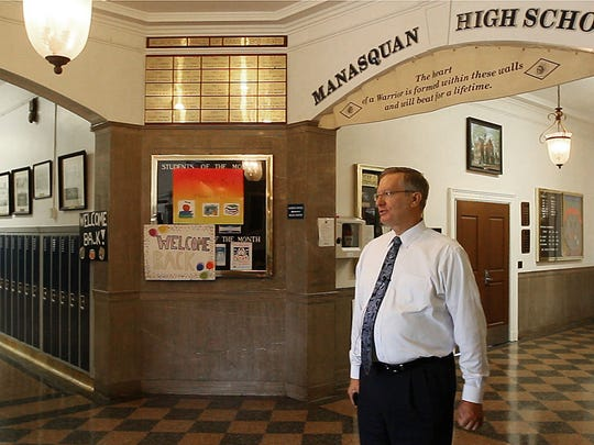 Bob Bielk/Staff photographer  Frank Kasyan, Manasquan superintendent, stands in the lobby of Manasquan High School