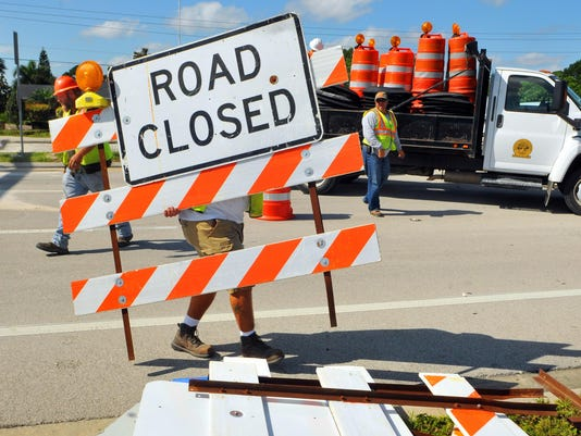 RE-OPENING A STRETCH OF PALM BAY RD