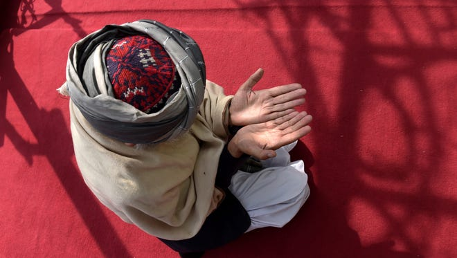In this photograph taken on March 12, 2015, Sufi Muslims pray at the Bahaduria Sufi mosque in Kabul, Afghanistan.