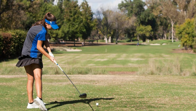 Westlake High's Marisa D'Amore tees off on the 10th hole at Los Robles Greens Golf Course Monday during the CIF-SS Northern Divison Team Championship Tournament. The Warriors won the team title.