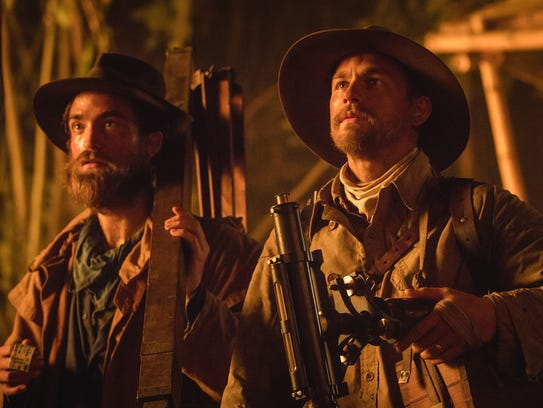 Robert Pattinson and Charlie Hunnam, right, in 'The