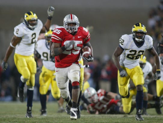 Ohio State's Antonio Pittman runs away from the Michigan