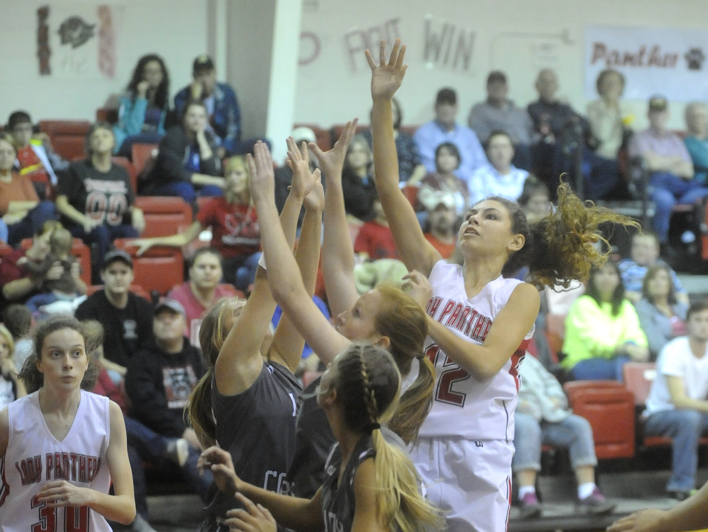 Norfork's Makayla Irby puts up a shot against Izard County on Friday night at Norfork.