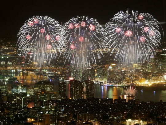 Macy's Fourth of July fireworks light up the sky over