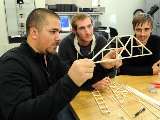 Several A&M-Corpus Christi engineering students discuss the strength of their bridge design. A background in civil engineering would allow a graduate to impact the city through the design and construction of bridges, roads and other important infrastructure.