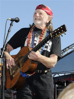 Willie Nelson performs before NASCAR's Sprint Cup Series auto race at Texas Motor Speedway, Nov. 7, 2010, in Fort Worth, Texas.