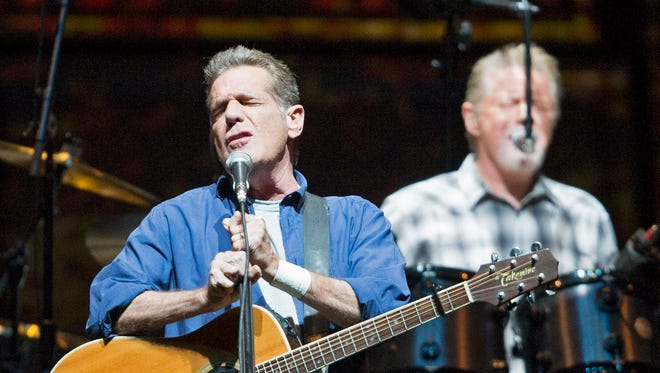 Glenn Frey (left) and Don Henley perform with The Eagles at Gila River Arena in Glendale during their History of the Eagles Tours October 1, 2014.