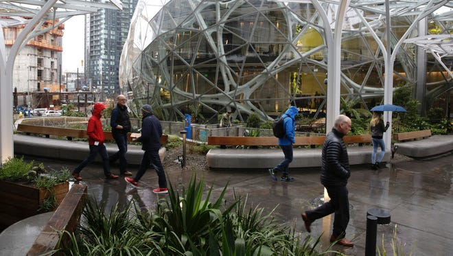 People take a tour during the grand opening of the Amazon Spheres in Seattle on Jan. 29, 2018.