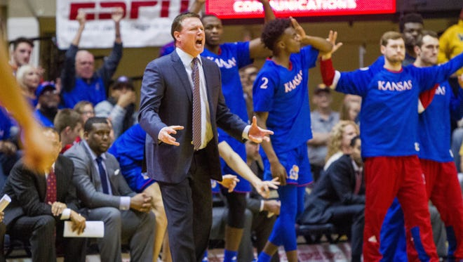 Kansas Jayhawks head coach Bill Self reacts on the bench after a made basket during the first half against the West Virginia Mountaineers at WVU Coliseum.