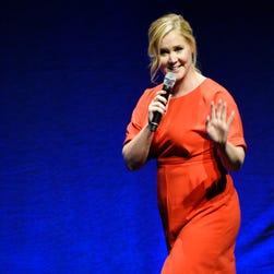 "FILE - In this April 23, 2015, file photo, Amy Schumer, the writer and star of the upcoming film ""Trainwreck,"" waves to the audience during the Universal Pictures presentation at CinemaCon 2015 at Caesars Palace in Las Vegas. Schumer, Queen Latifah and Sara Evans headlined the first annual 4th of July Freedom Festival at the Intrepid Sea, Air & Space Museum in New York City on Saturday,  July 4, 2015. (Photo by Chris Pizzello/Invision/AP, File) ORG XMIT: NY111"