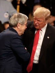 Iowa Gov. Terry Branstad is greeted by then-president-elect Donald Trump in December during Trump's post-election tour.