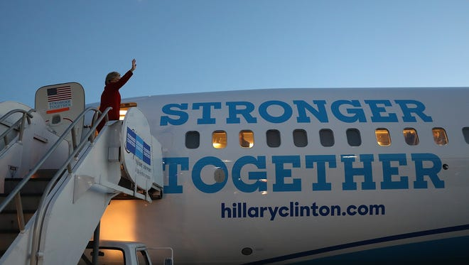 Hillary Clinton boards her campaign plane earlier this month in Michigan.