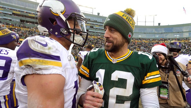 Green Bay Packers quarterback Aaron Rodgers (12) greets Minnesota Vikings wide receiver Adam Thielen.