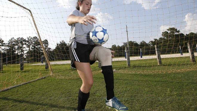 Erica Silvey, 13, who has been playing soccer since she was 5 on a prosthetic leg, dribbles the ball at Tom Brown Park on Tuesday, July 7, 2015.