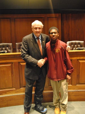 JaQuan Cottman poses for a photo with Sen. Jim Mathias during a school tour of Annapolis with the Student Government Association.