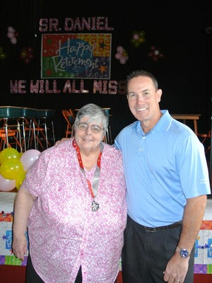 Sister Daniel Catherine and former pupil John Flaherty at St. Anthony School in Nanuet, where she was honored for 45 years of service.