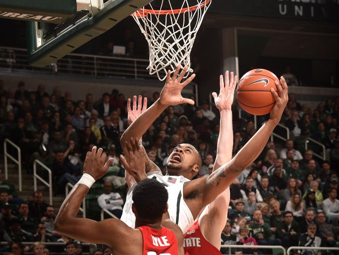 Michigan State's Nick Ward makes a tough shot under