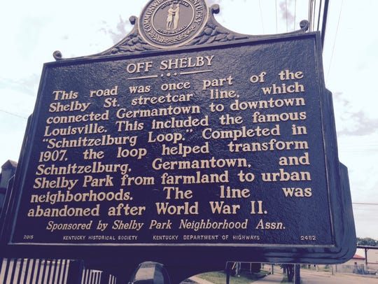 A state highway historical marker on Shelby Street