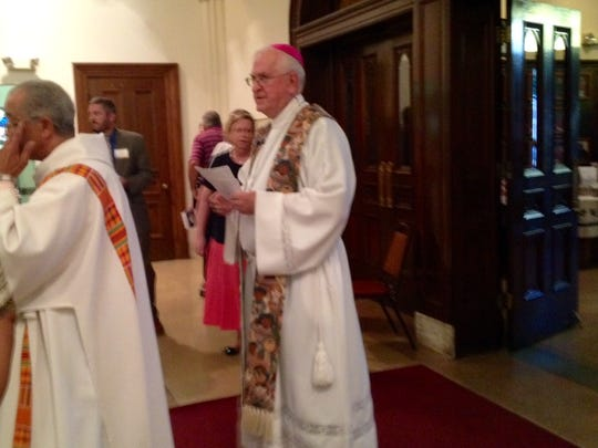 Louisville Archbishop Joseph Kurtz enters the sanctuary