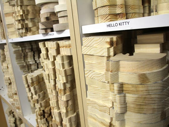 From Christmas themes to Hello Kitty, thousands of wooden pieces in dozens of varied patterns are stacked neatly on labelled shelves at Bennett's Beavers, in this 2015 photograph.