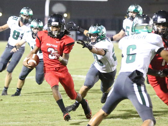 Ke'Shon Murray gains yards for South Fort Myers. South Fort Myers battled Venice in their Class 7A-12 Playoff game Friday night, November 13, 2015, at South Fort Myers.